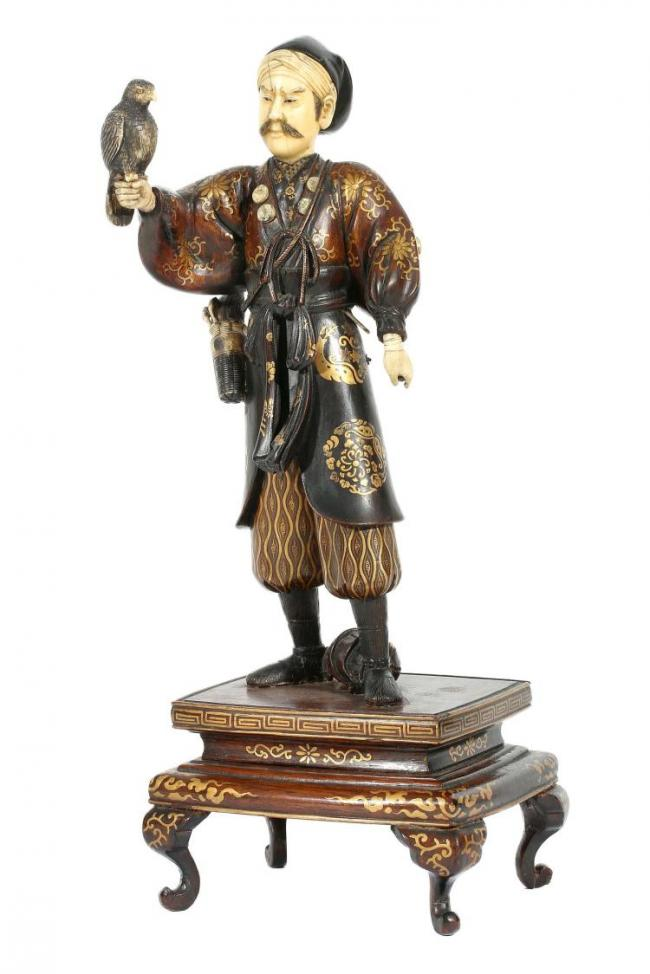 A LACQUER WOOD AND IVORY OKIMONO OF A FALCONER