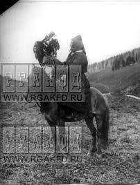 Falconer rider with his Golden Eagle on hawking in Siberia