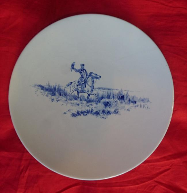 Plate with Russian falconer by M.S.Kuznetsov porcelain factory